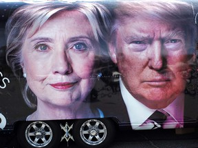 A TV van with pictures of Democratic candidate Hillary Clinton and Republican Donald Trump is seen prior to the first presidential debate at Hofstra University's David & Mack Sport and Exhibition Complex in Hempsted, N.Y., on Sept. 26, 2016. (JEWEL SAMAD/AFP/Getty Images)