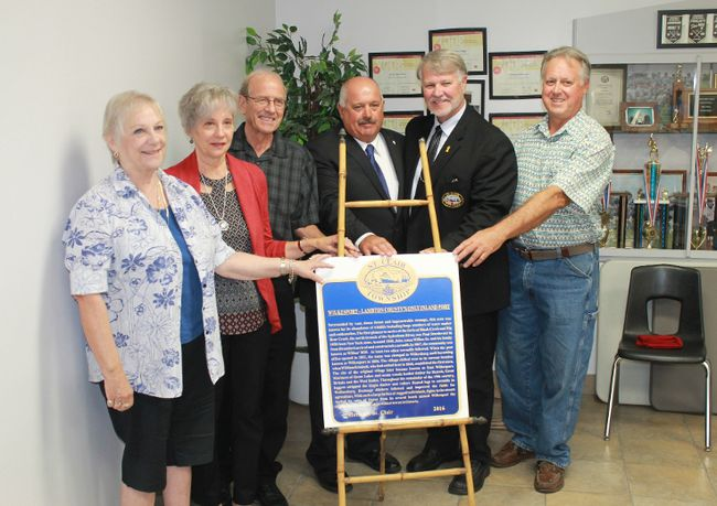 Heritage St. Clair's Wilkesport plaque was officially unveiled on Saturday, Sep. 17 at the Wilkesport Community Hall. From left to right: Diane Rose, Shirley Sturdevant, Lawrence Sturdevant, Lambton County Deputy Warden Ian Veen, St. Clair Township Mayor Steve Arnold, Heritage St. Clair chair David Pattenden.