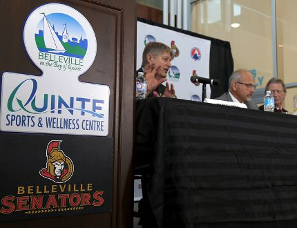 Emily Mountney-Lessard/The Intelligencer Belleville's director of recreation, culture and community cervices, Mark Fluhrer, Mayor Taso Christopher, Senators owner Eugene Melnyk are shown here during the press conference announcing the Ottawa Senators are relocating their AHL team to Belleville where they will become the Belleville Senators, at the Quinte Sports and Wellness Centre.