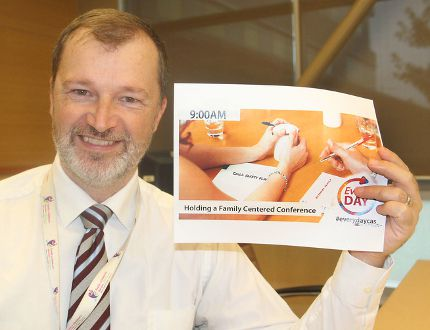 Steve Woodman, executive director of Family and Children's Services for Frontenac, Lennox and Addington, holds promotional items for an online project in which in-house stories about the agency and its work are told. (Michael Lea/The Whig-Standard)