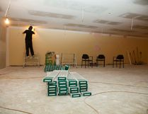 A worker sands down the drywall in the basement of the Vermilion Public Library on Friday, September 23, 2016, in Vermilion, Alta. The basement renovation is expected to be complete by Saturday, Oct. 1. Taylor Hermiston/Vermilion Standard/Postmedia Network.