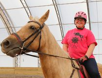 Alexis Bolt, Grade 12 student at Kingston Collegiate, is frustrated that her school bus is schedule to leave six minutes before classes let out of school in the afternoons this semester. She's seen here with her family horse Soleil in Westbrook. (Julia McKay/The Whig-Standard)
