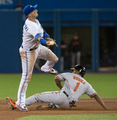 Toronto Blue Jay's Troy Tulowitzki tries to turn the double play against the Baltimore Orioles in the 9th in Toronto, Ont. on Tuesday September 27, 2016. Craig Robertson/Toronto Sun/Postmedia Network