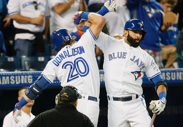 The Blue Jays Josh Donaldson is greeted by Jose Bautista after Josh hit a 2 run homer in the first inning as the Blue Jays play the Baltimore Orioles at the Rogers Centre in Toronto, Ont. on Tuesday September 27, 2016. Stan Behal/Toronto Sun/Postmedia Network