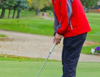 PCI's Owen Gillespie drains a putt during the MHSAA provincial golf championship Sept. 23 at Winkler Golf Club. (ALEXIS STOCKFORD/WINKLER TIMES/POSTMEDIA)