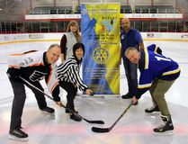 Hospital foundation executive director Janna Burke drops the puck for a face off between Timmins-Porcupine Rotary Club chairman Darren Taylor, left, and ER doctor Rick Kvas to mark the beginning of registration for the Face Off for Funds hockey tournament. Standing behind are Amanda Dyer representing Rogers Hometown Hockey and parks and arena manager Fred Salvador.