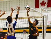 Canmore Collegiate High School volleyball player Malcolm Rogers tips the ball over the net during a tournament game against the Brooks Composite High School Buffalos at CCHS on Friday. Daniel Katz/ Crag & Canyon