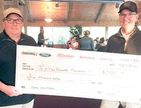 Bill Dingwall, president of The Dingwall Group, and Jeff Dingwall with a $5,000 cheque for the Lake of the Woods District Hospital Foundation, raised through a corporate charity golf tournament in the summer of 2016. The Dingwall Group has agreed to raise $40,000 to pay for the hospital foundation's purchase of a wireless fetal monitor so birthing moms can move around and aren't confined to a bed. SUPPLIED/Lake of the Woods District Hospital Foundation