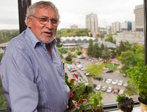 John Berry, a resident of a highrise near the forks of the Thames gestures out a side window towards the land around the MLHU and says that it is prime public property with a rich historical significance and should be used for something other than a highrise. (MIKE HENSEN, The London Free Press)