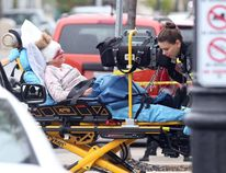 A elderly woman is transported to hospital after being stabbed in Windsor, Ont., on Sept. 28, 2016. (JASON KRYK / WINDSOR STAR)