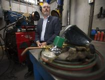 NAIT School of Skilled Trades Dean Malcolm Haines poses for a photo in a student welding booth, in Edmonton on Wednesday Sept. 28, 2016. Photo by David Bloom