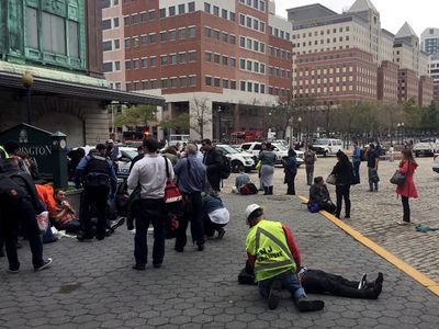 People are treated for their injuries outside after a NJ Transit train crashed in to the platform at Hoboken Terminal September 29, 2016 in Hoboken, New Jersey. (Photo by Pancho Bernasconi/Getty Images)