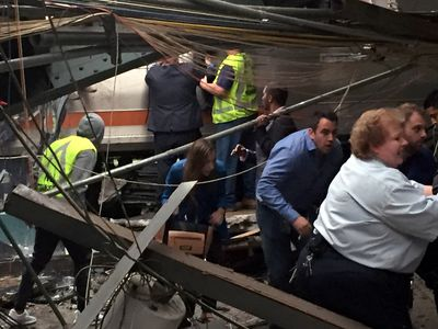Passengers rush to safety after a NJ Transit train crashed in to the platform at the Hoboken Terminal September 29, 2016 in Hoboken, New Jersey. (Photo by Pancho Bernasconi/Getty Images)