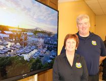 Point Edward Mayor Bev Hand and village CAO Jim Burns are pictured here with a shot of the Sarnia Bay Marina in the background. Village officials gathered at the Point Edward Community Hall Thursday to launch the municipality's very first promotional video. (Barbara Simpson/Sarnia Observer)