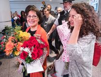 Homa Hoodfar, left, and her niece, Amanda Ghahremani, are greeted by friends and supporters as they arrive at Trudeau Airport Thursday, September 29, 2016 in Montreal. Hoodfar, a Canadian-Iranian academic was held in Iran's Evin prison for more than 100 days. (THE CANADIAN PRESS/Ryan Remiorz)