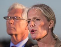 Catherine McKenna, front, Minister of Environment and Climate Change, announces the federal government's approval of the Pacific NorthWest LNG project as Jim Carr, Minister of Natural Resources, listens during a news conference at the Sea Island Coast Guard Base, in Richmond, B.C., on Tuesday September 27, 2016. (THE CANADIAN PRESS/Darryl Dyck)