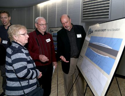 Greenwood Park residents Jean and Gary Richards talk to Mark Landridge of architectural firm DTAH of Toronto during an open house on the third crossing at La Salle Secondary School on Thursday. (Ian MacAlpine /The Whig-Standard)
