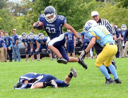 SAUGEEN SHORES - St. Mary's running back Robbie Monague (centre) leaps over his blocker as he avoids an incoming Saugeen District Royals defender in the Mustangs 29-0 win in Bluewater Athletic Association football action on Thursday.