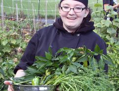 A bountiful harvest. Margo Norlock, a student of Fellowes High School's hospitality program, holds a bowl of vegetables and herbs picked from the school's garden. Freddie's Cafe, the school's cafeteria, used fresh produce from local sources, including from Fellowes' own garden.