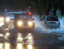 Vehicles pass through a section of Jefferson Blvd. that was flooded on Thursday, September 29, 2016, in Windsor, Ont. Heavy rains caused flooding in much of the area. (Dan Janisse/Windsor Star/Postmedia Network)