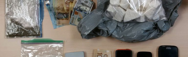 More than $100,000 in cocaine, cash and property seized by the Kingston Police Thursday night in Kingston, Ont. Photo supplied by the Kingston Police