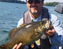 Columnist Frank Clark shows off a bass caught using a spinnerbait on a mixed weed and rock hump on Lake St. Francis during prefish last week. Photo supplied
