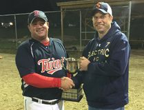 Micksburg Twins captain Jamey Mick accepts Greater Ottawa Men's Fastball Championship trophy from League President Adam Brown.