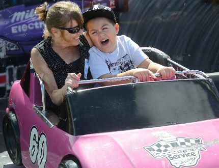 Tammy Campbell and her grandson Aiden Campbell, 7, of London, at the Western Fair's Day of Dreams Sept. 14. With the fair closed to the public,the midway was opened to special-needs kids who otherwise would have problems dealing with the crowds. Reviews on this year's fair have been mixed, with one letter writer suggesting changes need to be made to halt a slide into oblivion. (MORRIS LAMONT, The London Free Press)