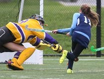 """Parkside's Gracie Clinton gets a shot under the diving Hayley Ostrander of East Elgin to make the score 3-0 for the dominant Stampeders during an afternoon series of TVRA field hockey games at the City Wide fields on Friday. Parkside won 4-0 after earlier beating Central Elgin 3-0 to improve to 6-0 without allowing a goal yet this season. Parkside coach Julie Cumberland said she has a young team this year, with a mix of rookies and vets learning to work together. """"A lot of Grade 9s and 10s are stepping up to the plate, however our Grade 9 rookies are solid, athletic and seem to read the field well and they're working well with our veterans."""" Cumberland sees Medway, Strathroy and Ingersoll as the Stampeders' main competitors. All seven TVRA teams met at City Wide Friday for one of six one-day tournaments that allow all the teams to play each other on the two turf fields, with each team having two games per day. Medway also won twice Friday to improve to 5-1, while Ingersoll is 4-2. (MIKE HENSEN, The London Free Press)"""