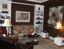 A living room inside the Skilbeck Cottage. Owner Gerry Legault has modernized the home to suit his tastes, but he's preserved the historic architectural features. (Barbara Simpson/Sarnia Observer)