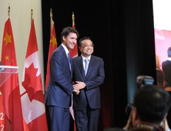 Canadian Prime Minister Justin Trudeau(L) and Chinese Premier Li Keqiang embrace on September 23, 2016 at a conference of the Canada China Business Council in Montreal, Quebec. (CLEMENT SABOURIN/AFP/Getty Images)