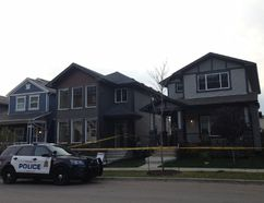 Edmonton police taped off a home on McConachie Blvd in northeast Edmonton Tuesday morning after reports of an aggravated assault and break and enter. PAIGE PARSONS/ Postmedia