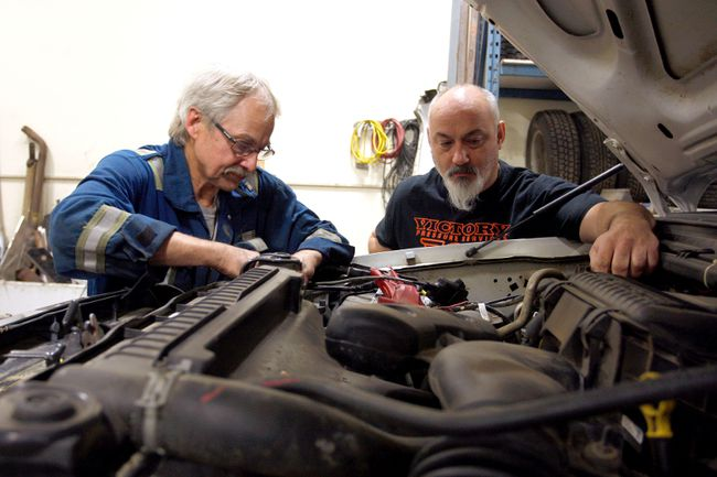 Jammer Mechanical Inc. owner Jim Jammer, right, looks on as mechanic Randy Schultz checks the battery and the charging system of a vehicle in the shop on Tuesday, in Grande Prairie. Schultz used to own Peace Auto and Electric but had to close. Jammer recently acquired the business and hired on Schultz to continue the electrical aspect of auto repairs. 