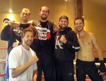 (From left to right in the back) Adam Funnell, Dillon Carman, Jason Kelly, Joshua Henshaw and (kneeling in front) Lance Denison take a break from sparring and pose for a photo. Kelly, from Brockville, is currently preparing to get back in the ring for the first time since breaking his back almost four years ago. Kelly will be fighting at Mississauga's Hershey Centre in February. (Contributed photo)