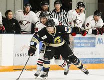Defenceman Evan Oberg of the Lacombe Generals fends off Innisfail Eagles forward Mark Bombersback during the Chinook Hockey League Pre-season Classic at the Innisfail Arena Sunday afternoon. The Eagles defeated the Generals 4-2. (Ashli Barrett, Lacombe Globe)