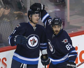 Winnipeg Jets left winger Kyle Connor (left) will get a look with the big club to close out the year. (Brian Donogh/Winnipeg Sun file photo)