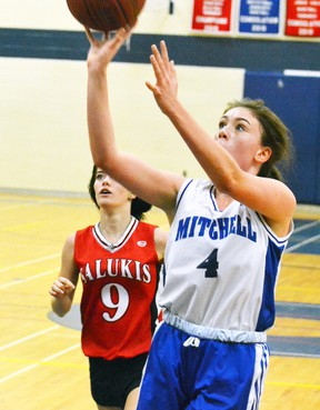During a junior girls basketball game against St. Marys DCVI at Mitchell District High School Oct. 5, MDHS junior Danica Hanson (4) drives to the basket. Hanson led all scorers with 10 points in a 35-16 victory. GALEN SIMMONS MITCHELL ADVOCATE