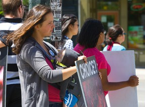 Anti-abortion protestors hold graphic signs picturing aborted fetuses during a protest in downtown London. A similar event in Strathroy got Jamie Greenwood thinking about the need to keep an open mind and respect others? beliefs. (MIKE HENSEN/The London Free Press file photo)