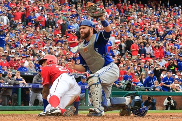 Russell Martin of the Toronto Blue Jays reacts after tagging out Ian Desmond of the Texas Rangers at home during the seventh inning of Game 2 of the American League Division Series at Globe Life Park in Arlington on Oct. 7, 2016 in Arlington. (Scott Halleran/Getty Images)