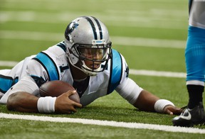 In this Oct. 2, 2016, file photo, Carolina Panthers quarterback Cam Newton lies on the turf after being hit against the Atlanta Falcons during the second half of a game in Atlanta. (AP Photo/Rainier Ehrhardt, File)