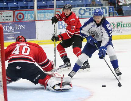 Ryan Valentini, right, of the Sudbury Wolves, puts a puck past goalie Michael McNiven, of the Owen Sound Attack, during OHL action at the Sudbury Community Arena in Sudbury, Ont. on Friday October 7, 2016. John Lappa/Sudbury Star/Postmedia Network