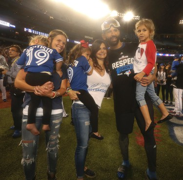 Jose Bautista with family after the sweep during ALDS Game 3 in Toronto, Ont. on Sunday October 9, 2016. Jack Boland/Toronto Sun/Postmedia Network
