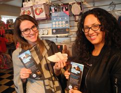 Avery Kloss (left), of ShopBrantford.com, and Sacha Pinto check out a baby slipper on display at Jack Rabbits, on George Street. They were at the store as part of the Brantford Business Crawl, which aims to encourage people to shop local. (VINCENT BALL/The Expositor