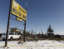 Detroyed vehicles and buildings are seen at the scene of a fatal fire at the Bashaw Motor Inn in Bashaw, Alberta on Tuesday, October 11, 2016. The fire broke out on Oct. 9.