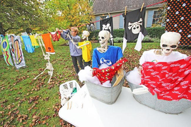 Even skeletons need clean clothes, and Vivian Line resident Melissa McKerlie was willing to lend a hand with the laundry featured in her unique Halloween display Tuesday. MIKE BEITZ/The Beacon Herald
