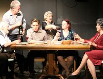 Frank (Harry Houston), Nunzio (Ian Gold), Nick (Jarrett Mills), Aida (Penny Martin), Caitlin (Kassandra Bailey) and Emma (Randi Mraud) gather for Sunday dinner in a scene from Sault Theatre Workshop's production of Over the River and Through the Woods.