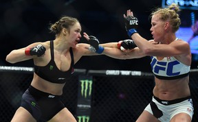Ronda Rousey (left) and Holly Holm fight during their UFC 193 bantamweight title bout in Melbourne, Australia, on Nov. 15, 2015. Rousey will return to the UFC on Dec. 30 in Las Vegas, fighting Amanda Nunes for the bantamweight title. (Andy Brownbill/AP Photo/Files)