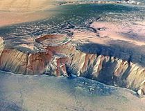 In this handout image supplied by the European Space Agency (ESA) on July 16, 2008, The Echus Chasma, one of the largest water source regions on Mars, is pictured from ESA's Mars Express. The data was acquired on September 25, 2005. An impressive cliff, up to 4000 m high, is located in the eastern part of Echus Chasma. Gigantic water falls may once have plunged over these cliffs on to the valley floor. The remarkably smooth valley floor was later flooded by basaltic lava. (Photo by ESA via Getty Images)