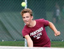 Ryan Baker of the McGregor Panthers watches his return shot during the boys' singles final against Chandler Haagsma of the Northern Vikings at the LKSSAA tennis championship Wednesday at the Chatham Tennis Club. (MARK MALONE/The Daily News)
