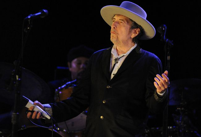 This file photo taken on July 22, 2012, shows U.S. poet and folk singer Bob Dylan performing during the 21st edition of the Vieilles Charrues music festival in Carhaix-Plouguer, western France. Dylan won the Nobel Literature Prize on Oct. 13, 2016, the first songwriter to win the prestigious award and an announcement that surprised prize watchers. (FRED TANNEAU/AFP/Getty Images)